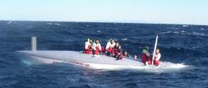 monohull racing sailboat capsize